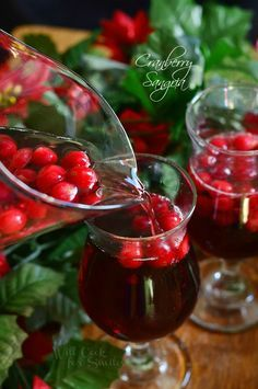 Cranberry Sangria ! Perfect for this Holiday season ! Delicious Cocktail made with fresh cranberries !