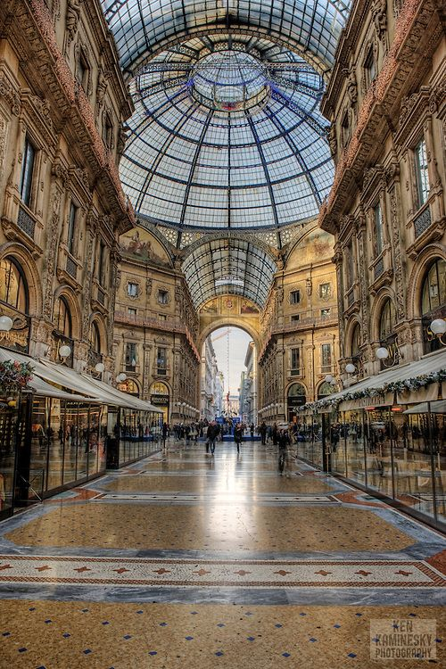 The Galleria Vittorio Emanuele II is a covered double arcade formed of two glass-vaulted arcades at right angles intersecting in an octagon; it is prominently sited on the northern side of the Piazza del Duomo in Milan, and connects to the Piazza della Scala. Named after Vittorio Emanuele II, the first king of united Italy, it was originally designed in 1861 and built by Giuseppe Mengoni between 1865 and 1877.