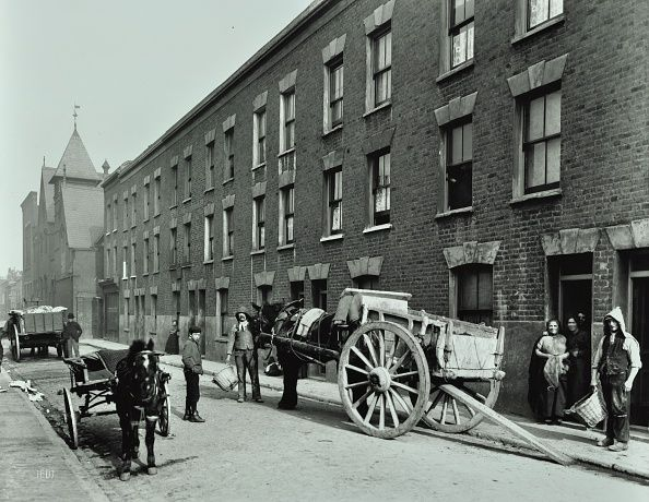 Dustmen and dust cart in Beckett Street Camberwell London 1903 A horse waits with a cart while men with baskets collect refuse from threestorey...