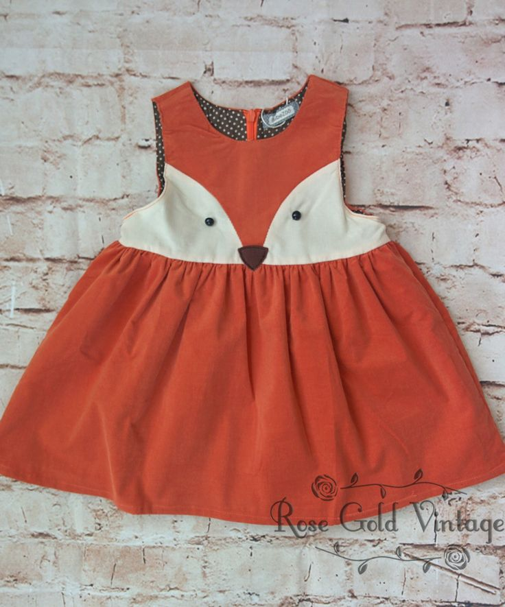 Adorable fine wale corduroy fox dress in burnt orange. Zip back, brown polka dot…