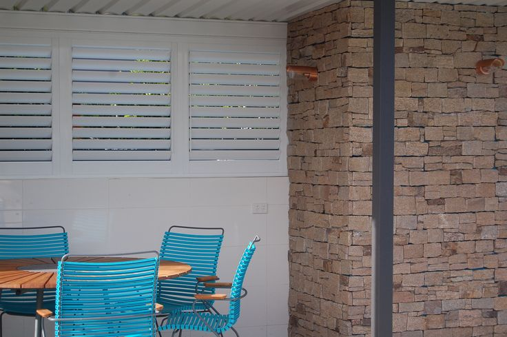 The Smoothness of the Aluminium Shutters against the texture of the Granite Stone is Stunning