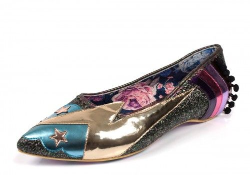 Irregular Choice Ground Control ballet shoes are a must for any David Bowie fan. The iconic lightning bolt in metallic gold adorns the side of the shoe along with blue clouds and gold stars at the toe. The pretty black and gold glitter upper also features a colourful rainbow at the heel decorated with a black bobble fabric edging. Irregular Choice Ground Control flat fashion shoes have a subtle pointed toe and metallic scallop trim to complete the colourful look.