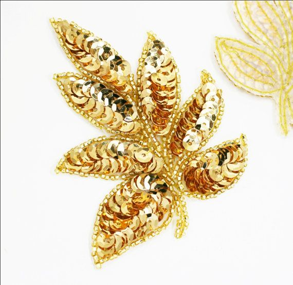 Gorgeous gold sequins and beading comprise this beautiful leaf-shaped applique.  Lovely for wedding/bridal, Gatsby head pieces, cake decor, sashes, etc..  Available in several colors...