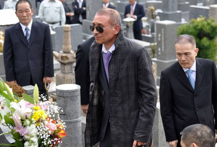 Centennial year: Kenichi Shinoda, the current leader of the Yamaguchi-gumi, pays his respects at the grave of one of his predecessors, Kazuo Taoka, in 2011.