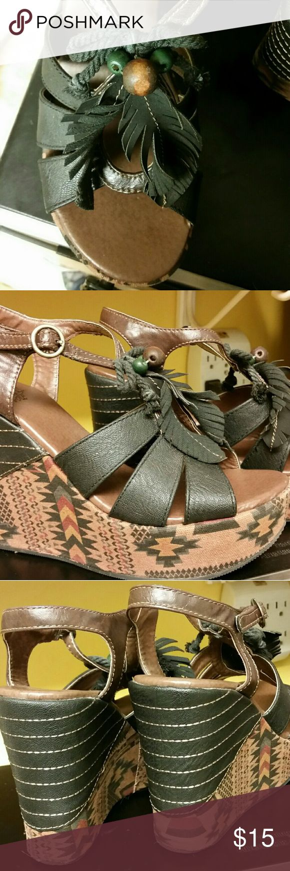 BKE Sole tribal/SW print wedges Style name is Albania. Tribal/SW print canvas. Black faux leather wraps around back of heel. Faux leather FEATHERS. Bead and rope details as well. I should've sent these on a lot sooner, they have yet to get the wear they deserve, but the faux leather ankle strap is juuuuuust starting to crack (see pic) also, there is a scuff on left toe (see pic). I can think of just 2 occasions on which these were worn and at $60.... smh another impulse buy. OFFERS WELCOME…