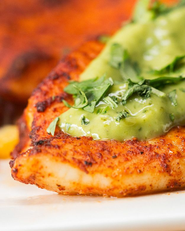 mix chili powder, cumin, cayenne, salt, and pepper with lime juice and olive oil. generously brush each side of the tilapia fillet with the marinade. Bake fish for 12 mins at 200 C until edges begin to crisp. While fish is baking, blend together avocado, cilantro, salt, pepper, lime juice, and yogurt. Serve topped with avocado crema and freshly chopped cilantro.