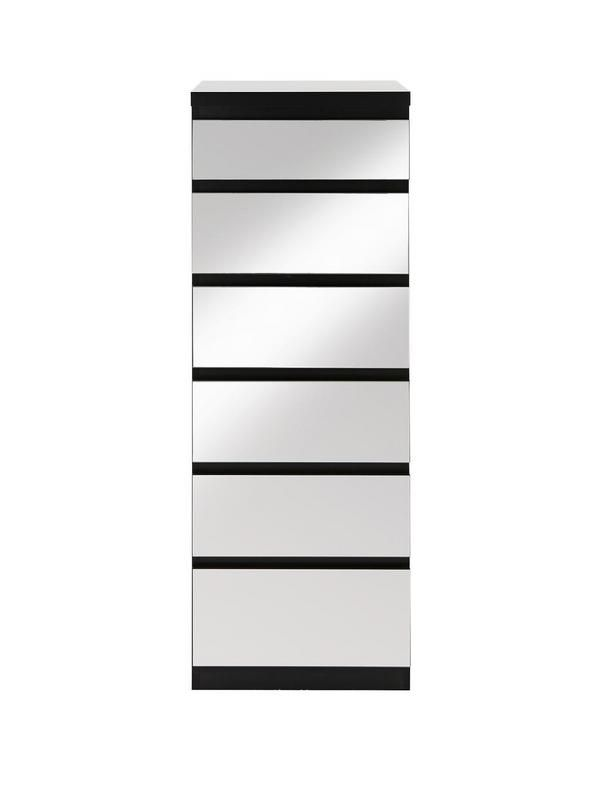 Prague Narrow Chest of 6 Drawers in Black or White with Mirrored Fronts Optional home assembly service* A best seller just got better - the popular Prague range is back in a brand new style that's all about a light-enhancing shine!This chest of drawers has a tall, narrow design that offers lots of storage room without taking up too much floor space. It comes in a trendy choice of dramatic black or bedroom-brightening white, and each one is given added wow by the mirrored drawer fronts tha...