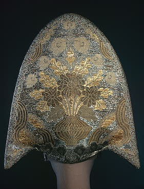 Woman's Headdress   Central Provinces   Russia. 19th century  Brocade, galloon, mother-of-pearl, imitation pearls and glass; embroidered. 40x40 cm   Source of Entry:  State Museum of Ethnography of the Peoples of the USSR, Leningrad (formerly in the collection of I.A. Galnbek). 1941