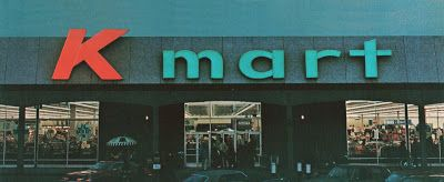 great early evening photo, from 1973, of the standard seventies Kmart exterior, Pleasant Family Shopping: Kmart - That 70's Store