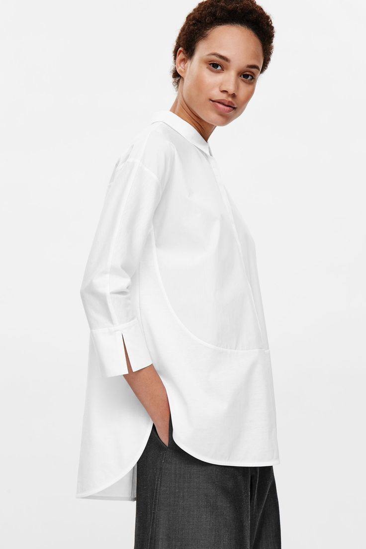 This shirt is made from a contrasting panels of smooth cotton poplin and a…