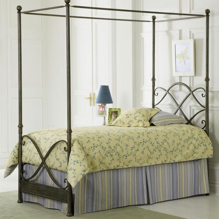 Captivating Vintage Dark Metal Canopy Bed Decor With Yellow Comforter With Green Leaves Pattern And Blue Valance Stainless Steel Canopy Bed