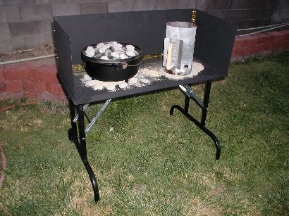 The ultimate in Dutch Oven cooking has to be the DO table! Rather than having to lean over to cook, the table positions the oven at just the right height. Sweet! The tables are made out of steel so there's no worry about the heat from the coals.- Desert Dawg