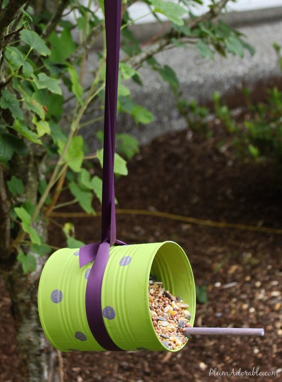 DIY Bird feeders from soup cans. I'd like some sort of block at the entrance so that all the seed doesn't pour out... but cute idea! :-D