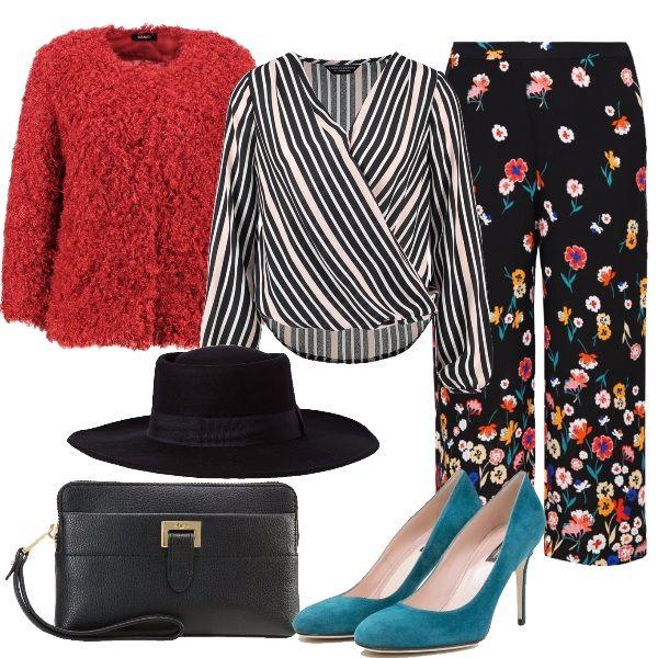 Mix di fantasie per la camicetta a righe e i pantaloni culotte a fiori. Ad aggiungere ancora più brio il pellicciotto riccio e le décolleté petrolio. Per completare la pochette nera e il cappello a tesa larga da fashionista.