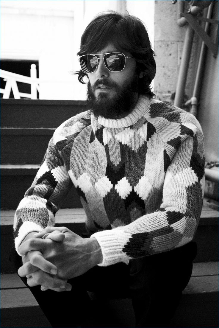 Appearing in a black and white image, Jared Leto wears a Prada sweater and trousers with Carrera sunglasses. - Sale! Up to 75% OFF! Shop at Stylizio for women's and men's designer handbags, luxury sunglasses, watches, jewelry, purses, wallets, clothes, underwear & more!