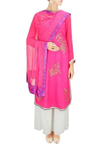 Featuring a bright pink chiffon Pakistani-style straight suit embroidered with gold sequins motifs in flower pattern and scalloped gota lace border on yoke, cuffs and border hem along with side slits. Team it up with white viscose georgette sharara and pink net dupatta with pink and purple floral lace border for that comfy yet so chic look!