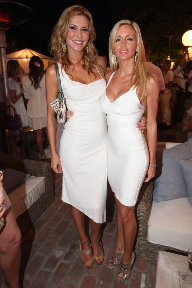 Brandi Glanville in DVF, and Camille Grammer in Herve Leger at Kyle RIchard's white party in RHOBH Season 2.