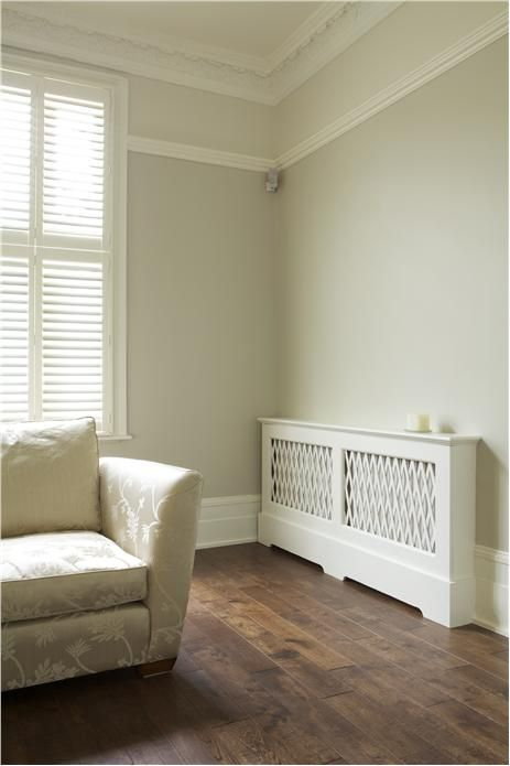 Lounge with walls in Shaded White (below rail) Modern Emulsion, Slipper Satin (above rail) Estate Emulsion, woodwork in Wimborne White Estate Eggshell and detailing in All White Soft Distemper.
