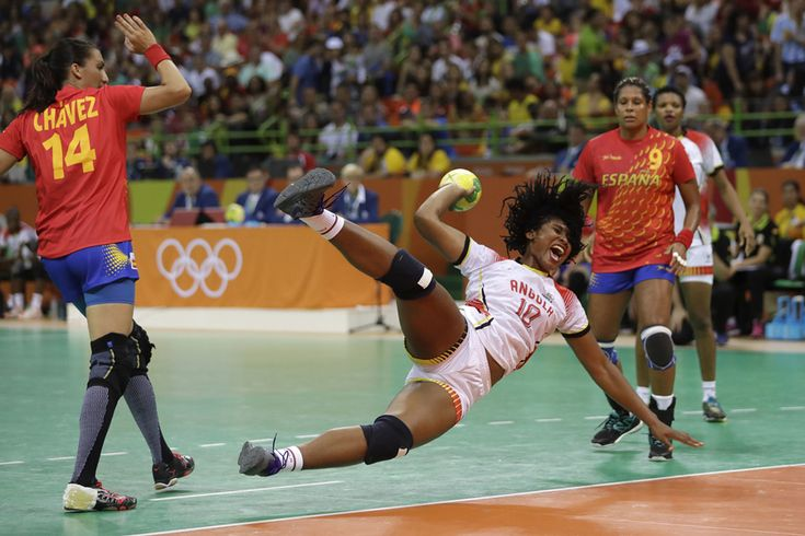 Angola's Albertina Cruz Kassoma, center, is fouled by Spain's Elizabet Chavez during the women's preliminary handball match between Spain and Angola on August 14, 2016. #