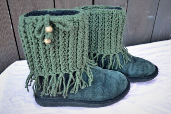 Unique Crochet Boot Cuffs With Fringes, Here Shown In A Beautiful Rich Olive Green Color. The Top Of The Boot Cuffs Features A Chained String With Matching Wooden Beads That Can Be Used To Tighten The                                                                                                                                                      More