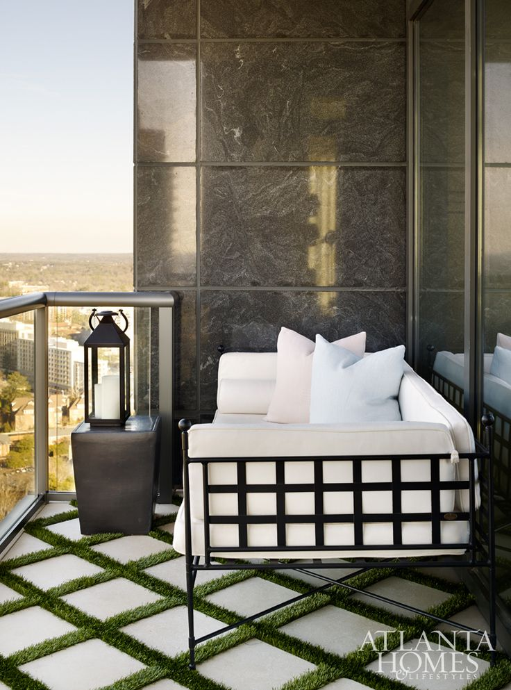 A small daybed on the balcony is perfect for outdoor lounging.