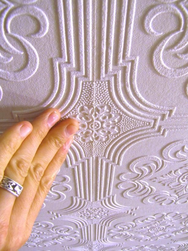 DIYNetwork.com shows how to jazz up a plain ceiling by applying embossed wallpaper.