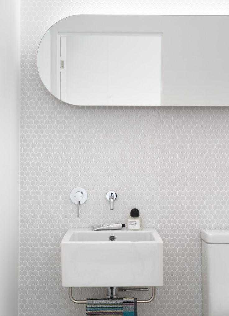 White mosaic tile wall. #hexagons. We have this tile, also available in a glossy black. @designBUILDLA