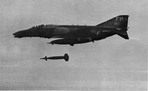 An F-4 drops a laser-guided bomb in Vietnam