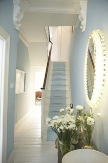 white painted floors with a blue wall, and a blue runner.