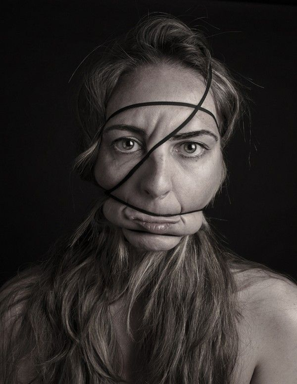 """""""Dismorfobina"""" is a series of photographs made by the Spanish artist Natalia Pereira based in Barcelona. A series of portraits whose face was disfigured by a rubber band wrapped tightly around the subject's head reflects """"the distortion of our identity when we are desperately trying to fit into a perfect mold that is not ours. An endless quest and need to be what we are not. """""""
