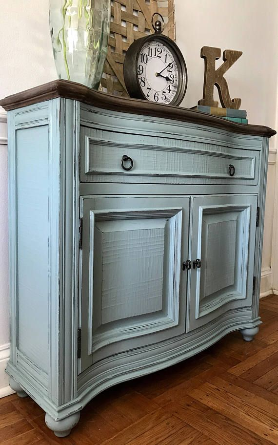 Console/Entry Piece hand painted in General Finishes Persian Blue, lightly distressed. Top has been faux wood painted in Annie Sloan Chalk Paints. Waxed for protection. 36.5w x 12d x 33.5h. Great center hall or entry piece wit storage below. Drawer and cabinet with shelf. Pick up