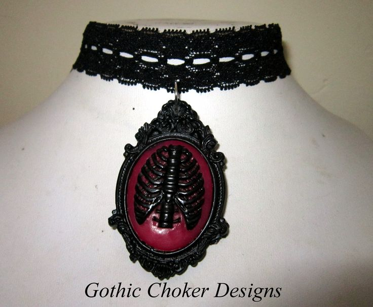 Black lace choker with black and red ribcage cameo. R120 approx $12.  Purchase here: https://hellopretty.co.za/gothic-choker-designs/black-lace-choker-with-red-ribcage