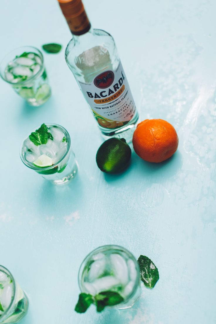 An orange twist on an old favorite. Tangerine mojito! All you need is mint leaves, 1 lime, seltzer water, ice, and Bacardí Tangerine Rum. [sp]