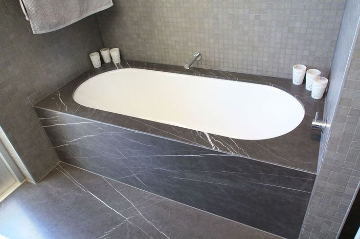 Honed Pietra Grey floor & bath hob tiles with Polished Medici Brown mosaic wall feature - Supplied by Sareen Stone. www.sareenstone.com.au
