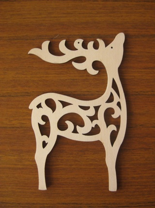 Basic lino print reindeer shape with 'ornamental' body. Horns, especially.