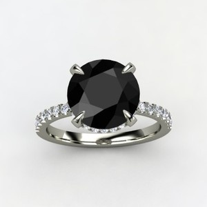 "Black diamond ring- When Carrie asked Big why he gave her a black diamond ring, he said ""because you aren't like anyone else"" Melted my heart!!!"