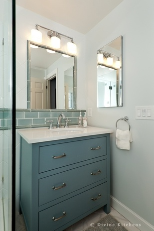 small bath, frameless shower door, gray and blue tile, painted, tiled mirror, medicine cabinet
