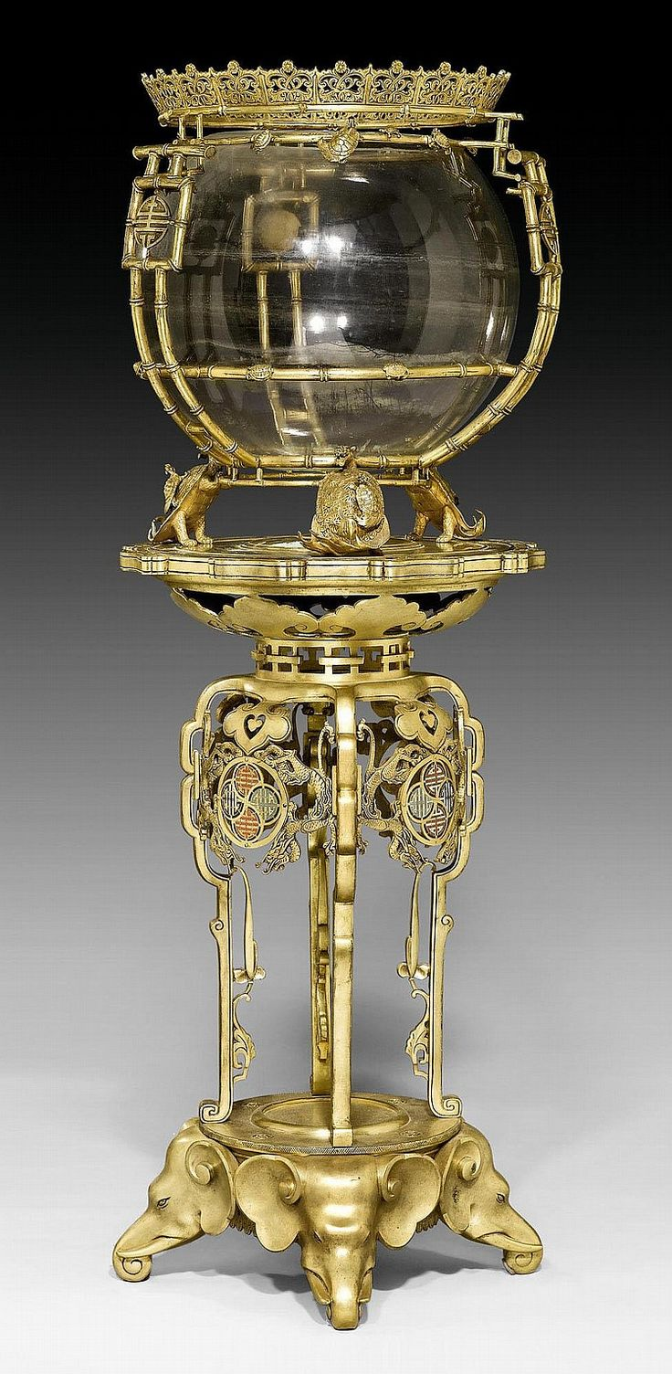 IMPORTANT AQUARIUM 'AUX TORTUES',Napoleon III, after designs by E. LIEVRE (Edouard Lievre, 1829-1886), attributed to F. BARBEDIENNE (Ferdinand Barbedienne, 1810-1892), Paris circa 1880/85. Matte and polished gilt bronze with fine cloisonne enamel. Glass container. H 154 cm. PRUNK-AQUARIUM 'AUX TORTUES', Napoléon III, nach Vorlagen von E. LIEVRE (Edouard Lièvre, 1829-1886), F. BARBEDIENNE (Ferdinand Barbedienne, 1810-1892) zuzuschreiben, Paris um ...