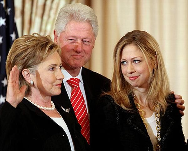 The Clinton's - Hillary taking the oath of office as Secretary of State of the United States, 2009.  With her is husband, Bill, former US President and daughter Chelsea.