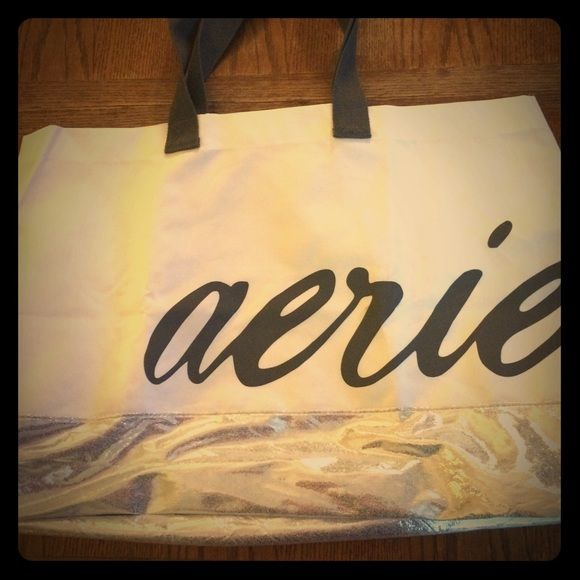 NWOT American Eagle outfitters tote bag This is a cute NWOT tote bag from American eagle outfitters. It is white with a pair of grey handles and a silver bottom. It says Aerie on it. Nice bag for the beach or the gym! American Eagle Outfitters Bags Totes