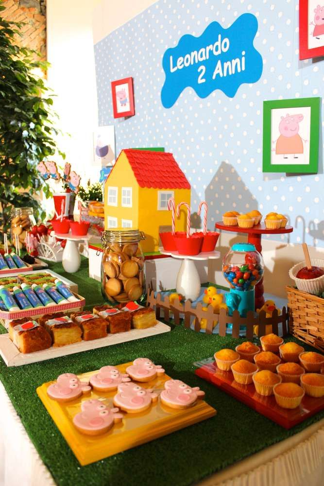 Colorful dessert table at a Peppa Pig birthday party! See more party planning ideas at CatchMyParty.com!