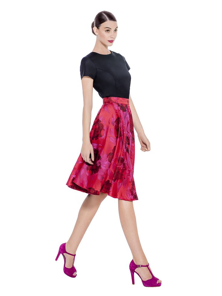 A deep red and magenta, knee length drapey skirt with high waist is decorated with an opulent floral jacquard pattern. Pair with a refined black top and simple accessories to let this skirt take centre stage at an evening work party. Fabric imported from France: 100% Polyester / Jacquard Lining imported from Germany: 57% Viscose 40% Polyimide 3% Elastane Washcare: Dry clean MADE IN EUROPE