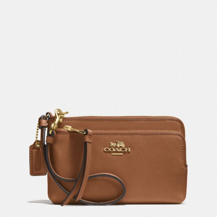Front pocket with zip for iPhone     The Double Zip Wristlet In Leather from Coach | Should fit iPhone 6