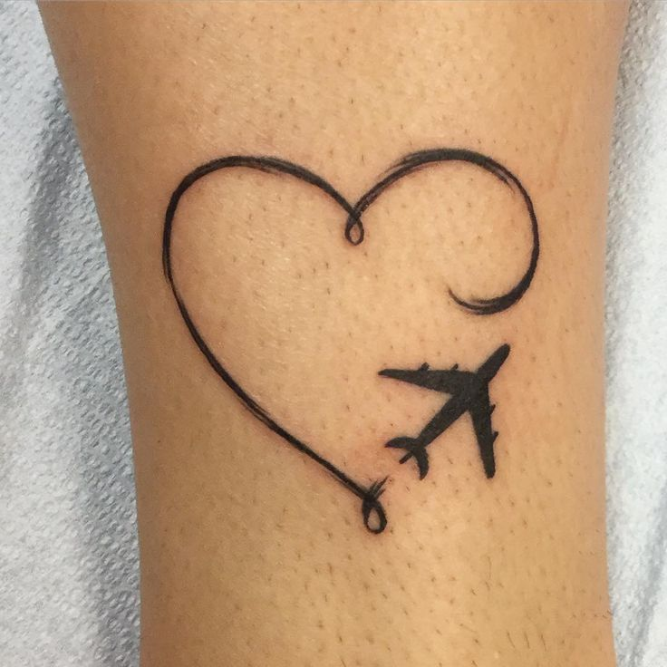 "#wanderlust ""Did this simple #paintstroke #hearttattoo with a plane last night. I don't mind doing the little tattoos. #tattoo #traveltattoo #travel #girlswithtattoos…"""