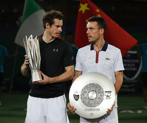 Winner's Andy Murray of Britain, left, chats with Roberto Bautista Agut of Spain after the award ceremony for the men's singles final match at the Shanghai Masters tennis tournament at Qizhong Forest Sports City Tennis Center in Shanghai, China, Sunday, Oct. 16, 2016. (AP Photo/Andy Wong)
