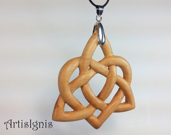 Beautifully handcarved pendant, completely handmade in alder wood with a gorgeous Celtic Triquetra with heart knot. The Triquetra symbolizes the