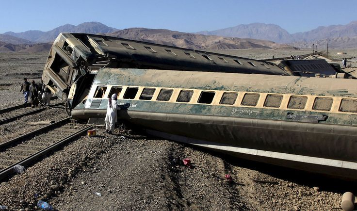 A passenger looks for his belongings after a #trainderailed in #Quetta, #Pakistan.