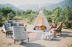 Southwestern tipi lounge, vintage furniture, poufs, layered rugs, w/ plenty of pillows to sink into… this entire wedding is a created w/ vintage one of a kind pieces. Southwestern, gypsy, boho.