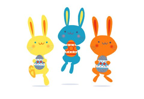 easter bunny hiding easter eggsand looking cute rabbit