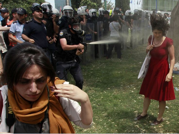 Protests in Turkey continue and above, a photo that will join the ranks with other infamous instances of police brutality.